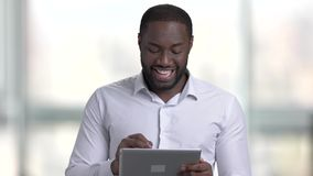 Confident afro american with tablet. stock video footage