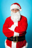 Confident aged male in Santa costume Stock Images