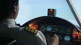 Confident airliner pilot flying in turbulence zone, keeping flight under control. Stock footage stock video