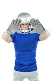 Confident American football player defending. Portrait confident American football player defending against white background royalty free stock image