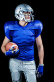 Confident American football player looking away Stock Images