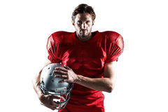Confident American football player in red jersey holding helmet Royalty Free Stock Photography