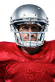 Confident American football player in red jersey Stock Images