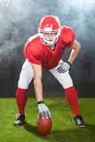 Confident american football snapper on field Stock Photo