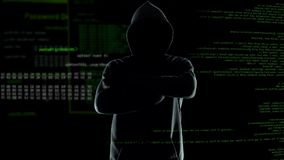 Confident anonymous watching his hacker program cracking passwords and firewalls. Stock footage stock video