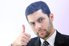 Confident arab business man with thumb up. Image of arab businessman wearing black suit and feeling confident with his success and raising thumb up Stock Photography