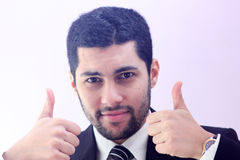 Confident arab business man with thumb up. Image of arab businessman wearing black suit and feeling confident with his success and raising thumb up Royalty Free Stock Photography