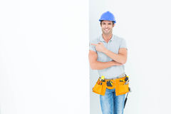Confident architect with bill board over white background Royalty Free Stock Image