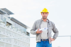 Confident architect with blueprints outdoors Royalty Free Stock Photos