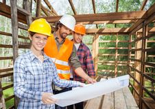 Confident Architect With Colleagues Examining Royalty Free Stock Images