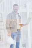 Confident architect with hardhat and laptop in office Royalty Free Stock Photos
