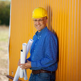 Confident Architect Holding Blueprints While Leaning On Trailer Royalty Free Stock Photos