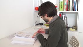 A confident architect male working with architectural plan