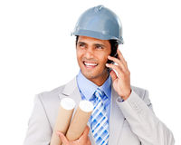 Confident architect on phone carrying blueprints Stock Photography
