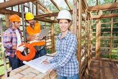 Confident Architect Working On Blueprint With Royalty Free Stock Image