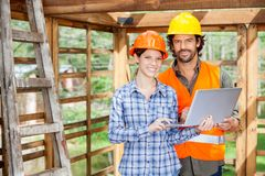 Confident Architects With Laptop At Construction Stock Images