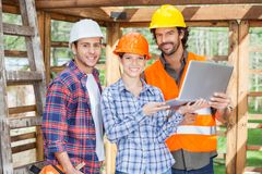 Confident Architects With Laptop At Site Stock Images