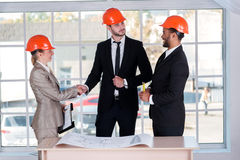 Confident architects shaking hands Royalty Free Stock Images