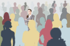 Confident Asian business woman in a crowd Stock Photo
