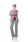 Confident Asian business woman. Hold document, full length portrait isolated on white background Royalty Free Stock Images