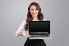 Confident asian business woman showing laptop screen. Confident asian business woman showing laptop screen Royalty Free Stock Photo