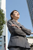 Confident Asian business woman standing in outside of office in Royalty Free Stock Photography