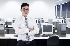 Confident asian businessman in office Royalty Free Stock Photos