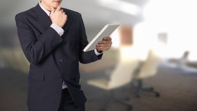 Confident Asian businessman reading notebook or document file in Royalty Free Stock Image