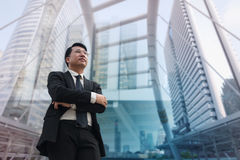 Confident Asian Businessman standing and looking at city for vis. Confident Asian Businessman standing and looking  at city for vision concept Royalty Free Stock Photography