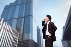 Confident Asian Businessman standing and looking at city for vis. Ion concept Royalty Free Stock Photos