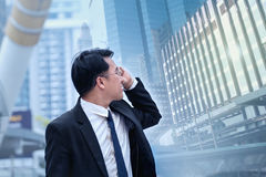 Confident Asian Businessman standing and looking at city for vis. Confident Asian Businessman standing  and looking at city for vision concept Stock Photography