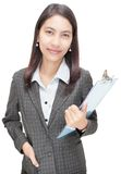 Confident Asian businesswoman w clipboard Royalty Free Stock Photography