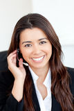 Confident asian businesswoman wearing headphones Royalty Free Stock Image