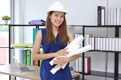 Confident Asian engineer woman smiling in workplace of office royalty free stock photos