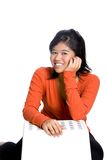 Confident Asian girl in orange top . Royalty Free Stock Images