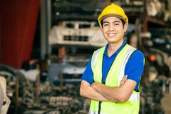 Free Confident Asian Male Engineer Worker Standing Arm Crossed Happy Smile For Enjoy Working In Factory Royalty Free Stock Image - 216171076