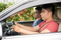 Confident Asian Man Driving Car Royalty Free Stock Photography