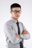 Confident Asian man. Portrait of confident young businessman in glasses Stock Photos