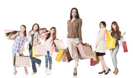 Confident Asian shopping woman with her friends Royalty Free Stock Images