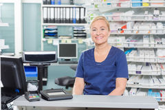 Confident Assistant Sitting At Cash Counter In Stock Images