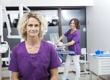 Confident Assistants Smiling In Dentist Clinic stock photography