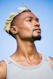 Confident athlete wearing wreath Stock Image