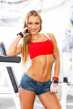 Confident athletic woman posing in gym Royalty Free Stock Photography