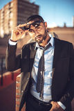 Confident attractive Arab businessman in urban environment Royalty Free Stock Photo