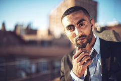 Confident attractive Arab businessman in urban environment Stock Photography