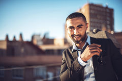 Confident attractive Arab businessman in urban environment Stock Images