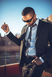 Confident attractive Arab businessman in urban environment Royalty Free Stock Image