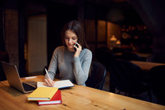 Confident attractive female administrative manager of coffee shop Royalty Free Stock Image