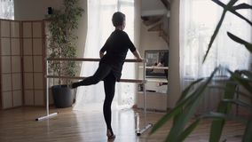 Confident attractive flexible mature ballerina with great body dancing at home in front of the mirror. Elegant slim. Confident attractive mature ballerina with stock video footage