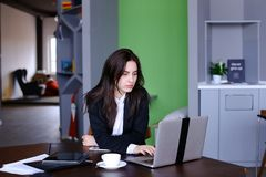 Portrait of beautiful female secretary who poses and looks away Royalty Free Stock Photos
